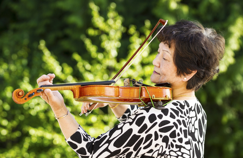older woman playing violin