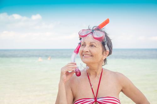 elder woman snorkeling