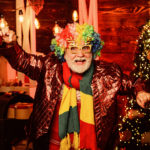 Cheerful Clown Colorful Hairstyle. Bearded Grandfather Senior Ma